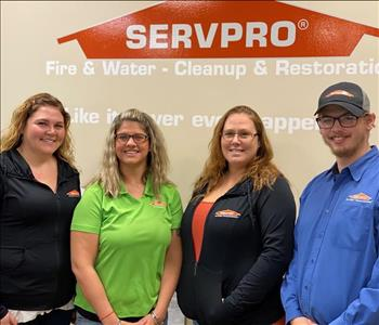 3 females and 1 male wearing SERVPRO shirts